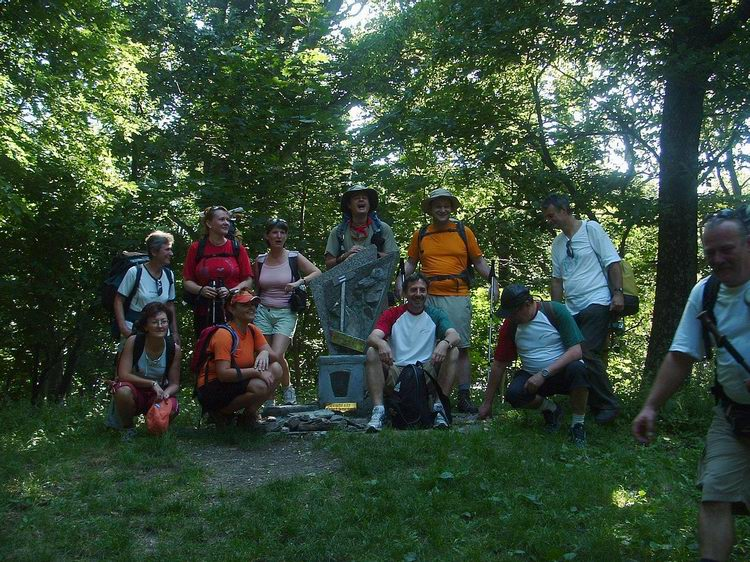 Hiker team at the small monument of the Blue Trail