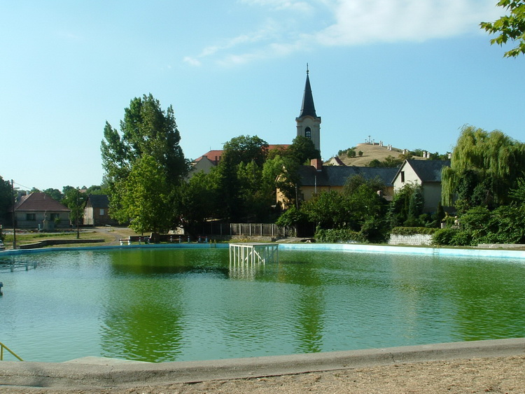 The Lake Bath of Bodajk village. You can see the Calvary Hill in the background
