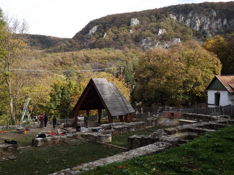 The ruins of the monastery at the foot of the rocky mountainside