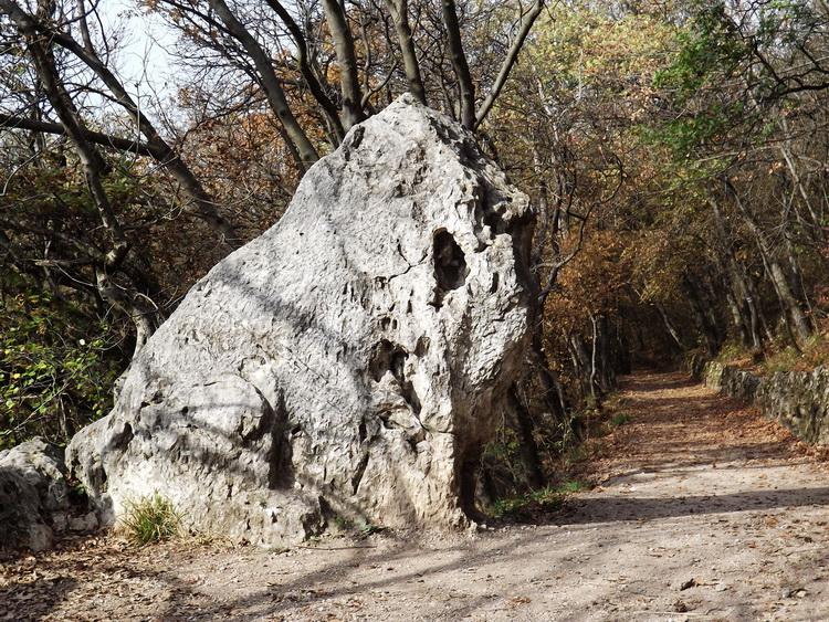The headless Lion Rock stands beside the gravel promenade