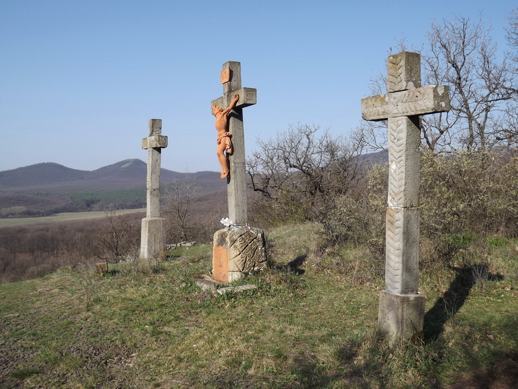 The crosses of the Calvary stand above Kóspallag