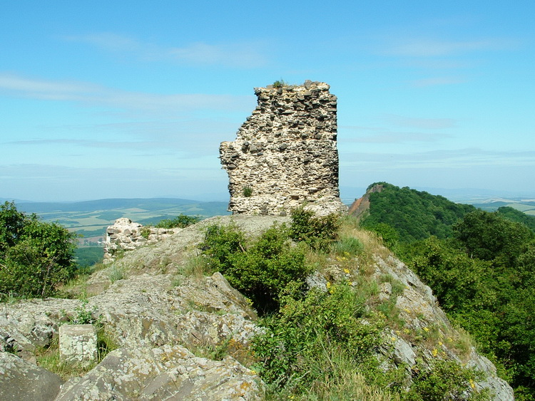 The ruins of Szandavár Castle on the top of the mountain
