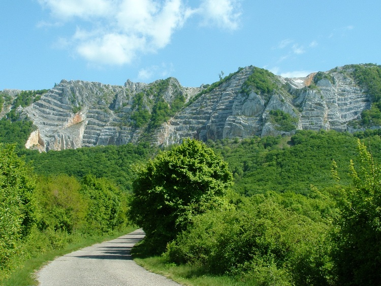 The panorama of Bél-kő Mountain taken from the asphalt road
