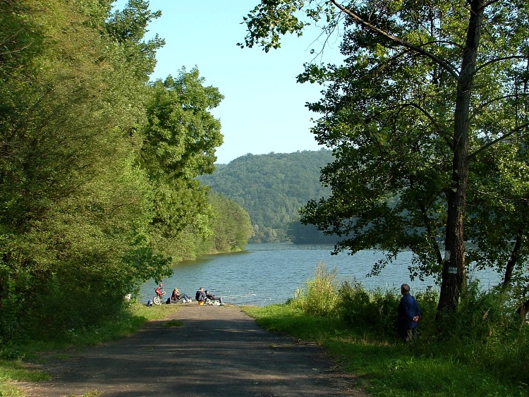 The old asphalt road disappears unter the surface of the lake