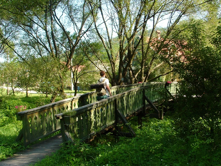 Wooden pedestrian bridge over the creek in Uppony