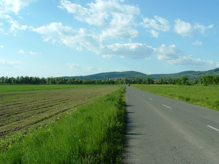 Asphalt road leads on the plain of Sajó River towards Putnok and the hills
