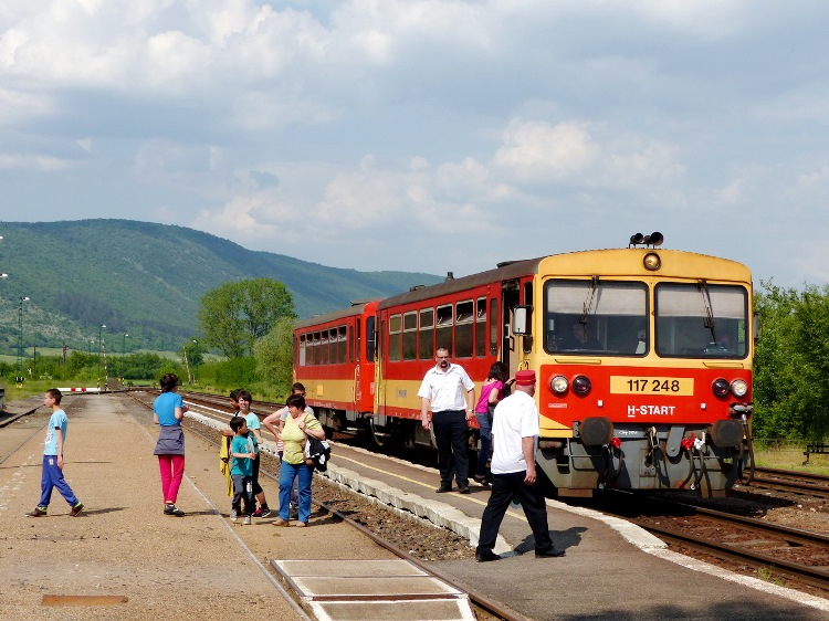 Arriving train at Bódvaszilas railway station. The last ridge of Aggtelek Hills stands in the background.