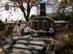 Piliscsév - Világháborús emlékmű a templom mellett