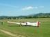 Motoros vitorlázórepülő a mezőn