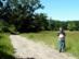 Földúton halad a kéktúra a Palócki-rét szélén