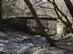 A Törökmező turistaház után egy rozzant hídon keresztezzük a Malom-völgyi patakot