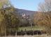 Kilátás a házak között Kóspallag római katolikus templomára