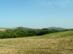 Kilátás a Cser-hátról a Szanda-hegy és a Berceli-hegy bányáira