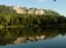 A Bél-kő panorámája a Gyári-tó partjáról alkonyatkor